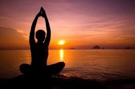 person doing yoga at sunrise