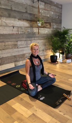 yoga teacher on a yoga mat